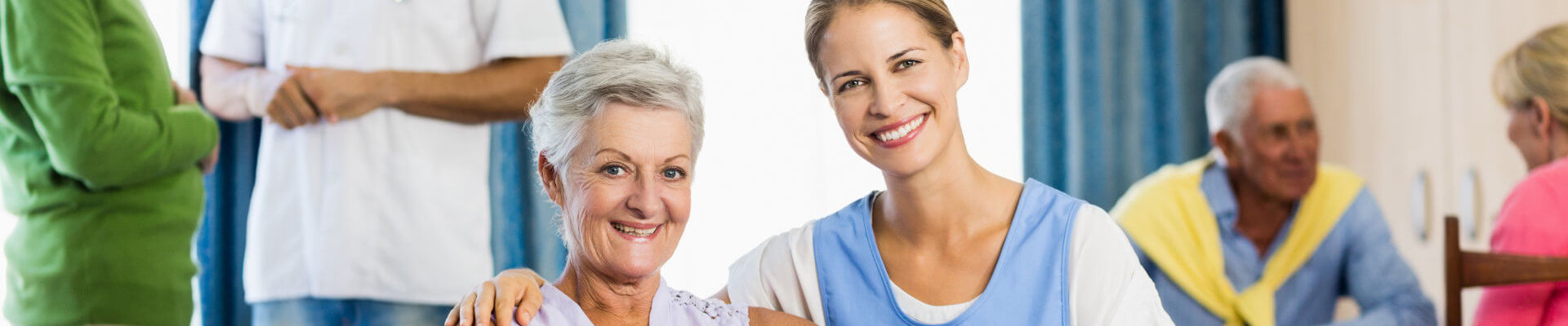 caregiver and the senior woman smiling